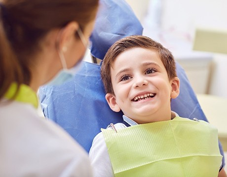 young boy smiles while visiting his Gainesville children's dentist