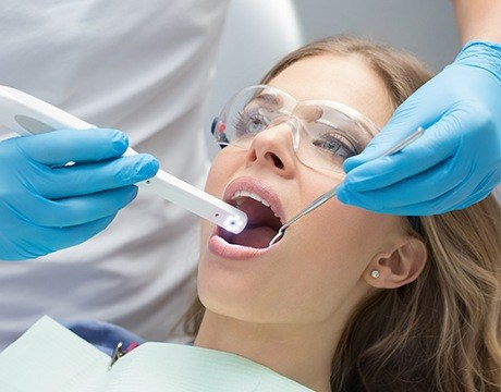 Dentist capturing intraoral images