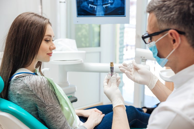 woman smiling while talking to dentist