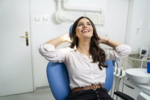 Relaxed woman visiting her Gainesville sedation dentist