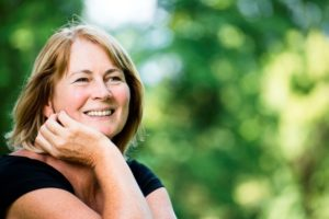 Older woman with dental implants in Gainesville